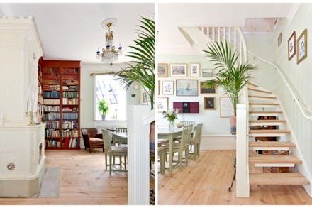 Åter i vardagsrum/matrum med kakelugn och trappa upp till övre plan