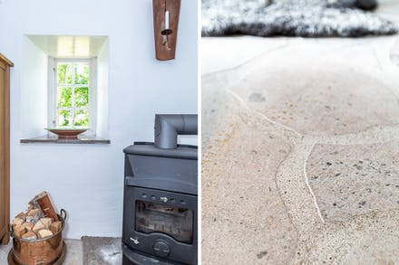 Värmande braskamin och detaljbild på golvet.
