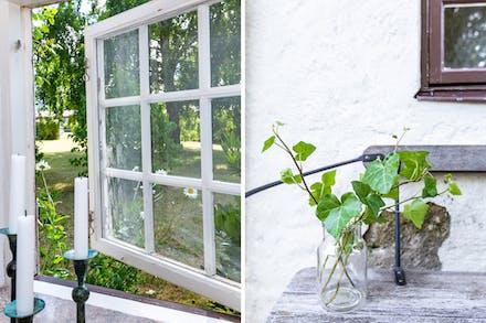 Spröjsade fönster och putsad fasad.
