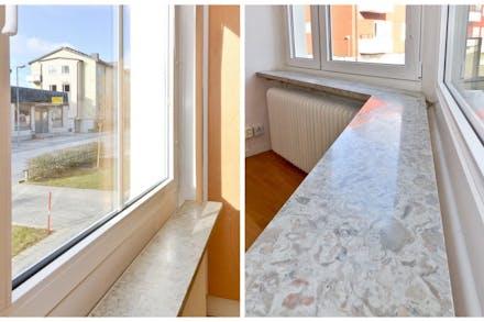 Fina kalkstensskivor vid fönsterna i alla rum