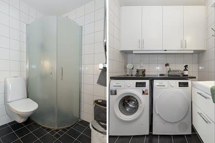 Välutrustat badrum med helkaklade väggar och klinkergolv med golvvärme