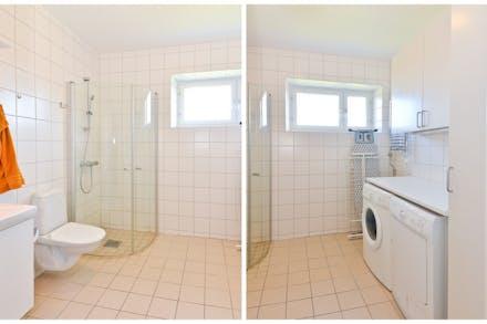 Stort badrum med egen tvättmaskin och torktumlare