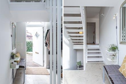 Hall/entré med kalkstensgolv och förbindelse till både källaren och nedre plan