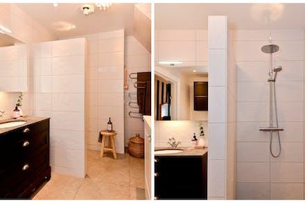 Kommod med stenskiva och bra dusch bakom kaklad vägg