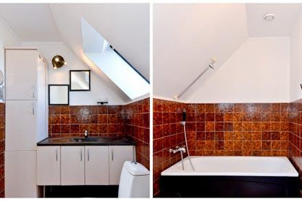 Badrum med badkar, kakel och våtrumsmatta i original