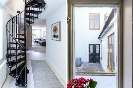 Spiraltrappa / fönster från kök i riktning mot utgång nr 2 från hall/entré